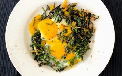 Eggs in a Nest of Sautéed Dandelion Greens