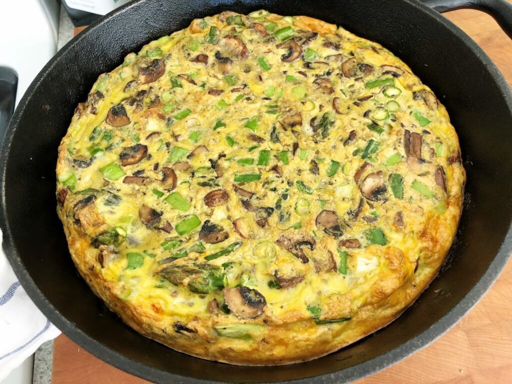 Asparagus and Mushroom Frittata in cast iron pan.